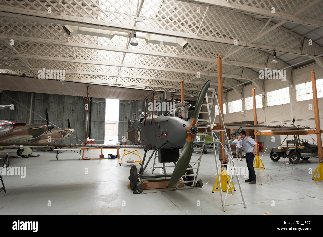 Duxford Cambridgeshire, UK. 20th July, 2017. A rare first World War De Havilland DH9 bomber aircraft has been fully restored and is now being assembled for display and flight at the Imperial War Museum. The plane is 100 years old, being assembled in a WW1 hanger on the 100th anniversary of the Imperial War Museum. The plane is the only one in the UK and has been restored after being found in an elephant stable at the Palace of Bikaner, Rajasthan, India. Credit: Julian Eales/Alamy Live News Stock Photo