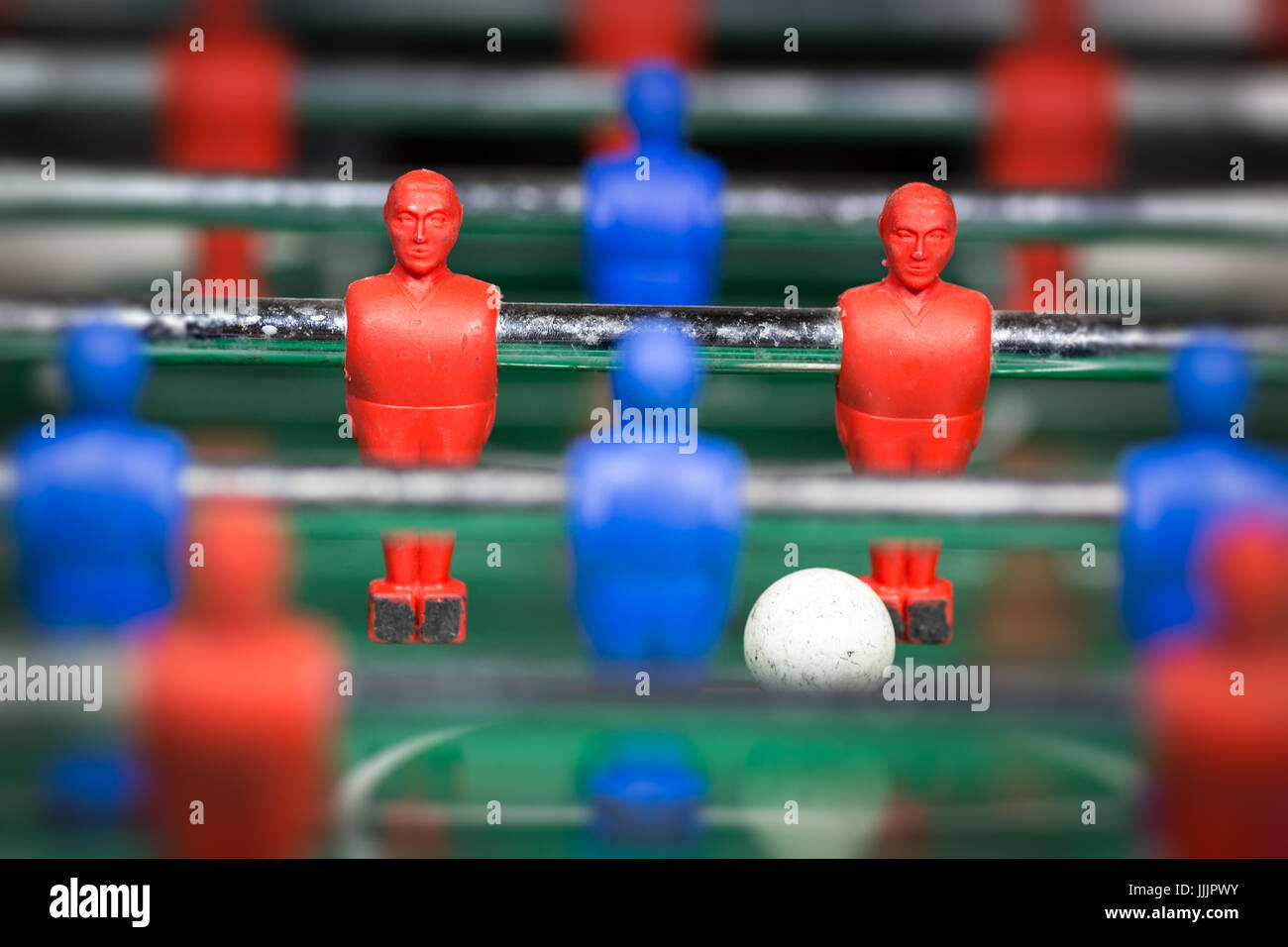 Table soccer player figurines with football - Stock Image