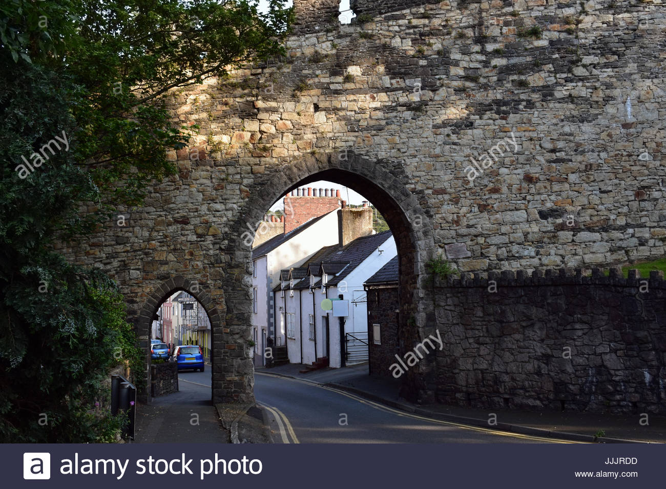 Portal in the Conwy Town Walls during sunset - Stock Image