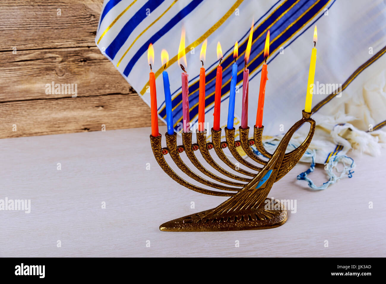 jewish holiday Hanukkah with menorah over wooden table - Stock Image