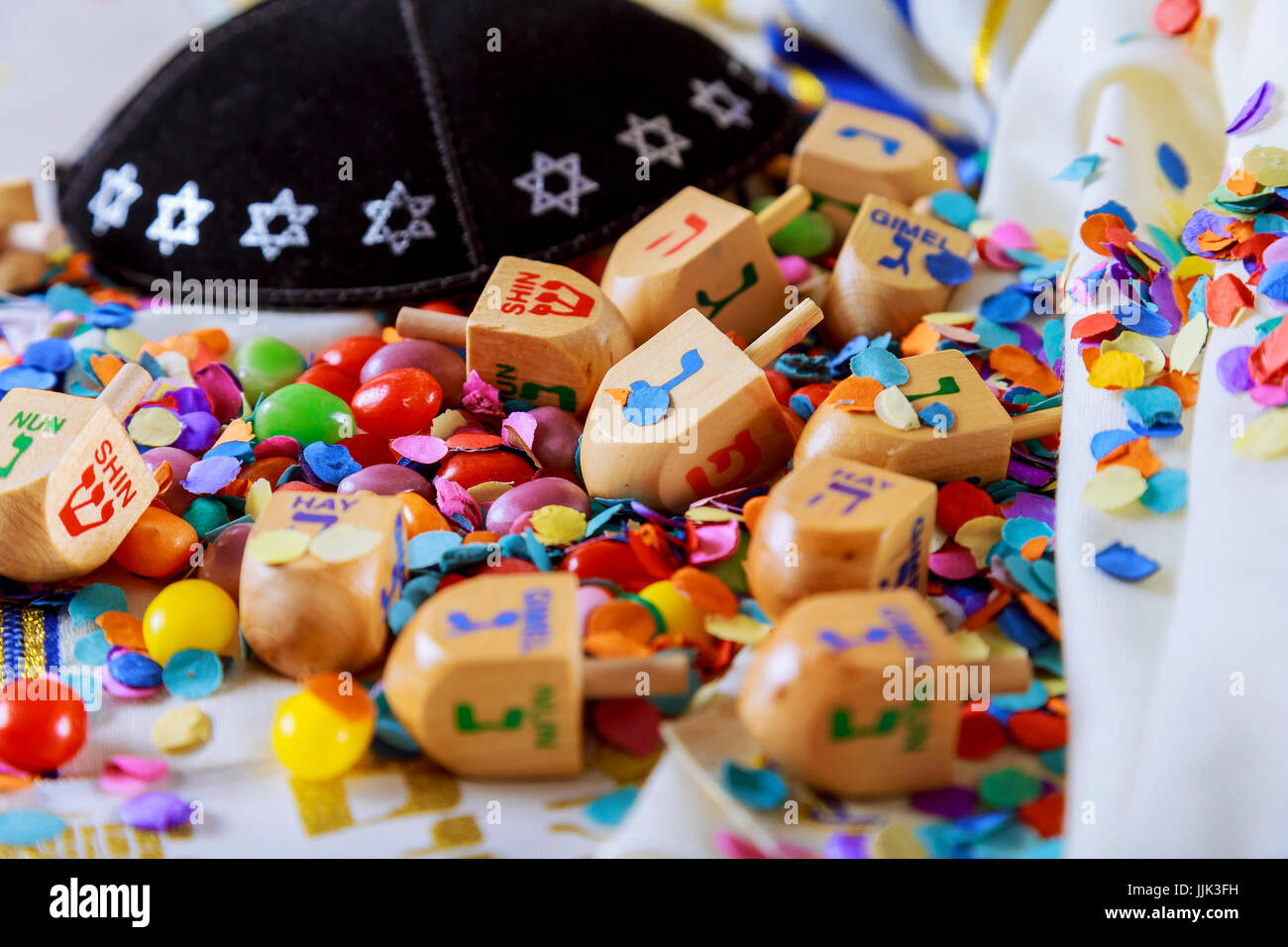 Jewish holiday Dreidel still life composed of elements the Chanukah Hanukkah festival. - Stock Image