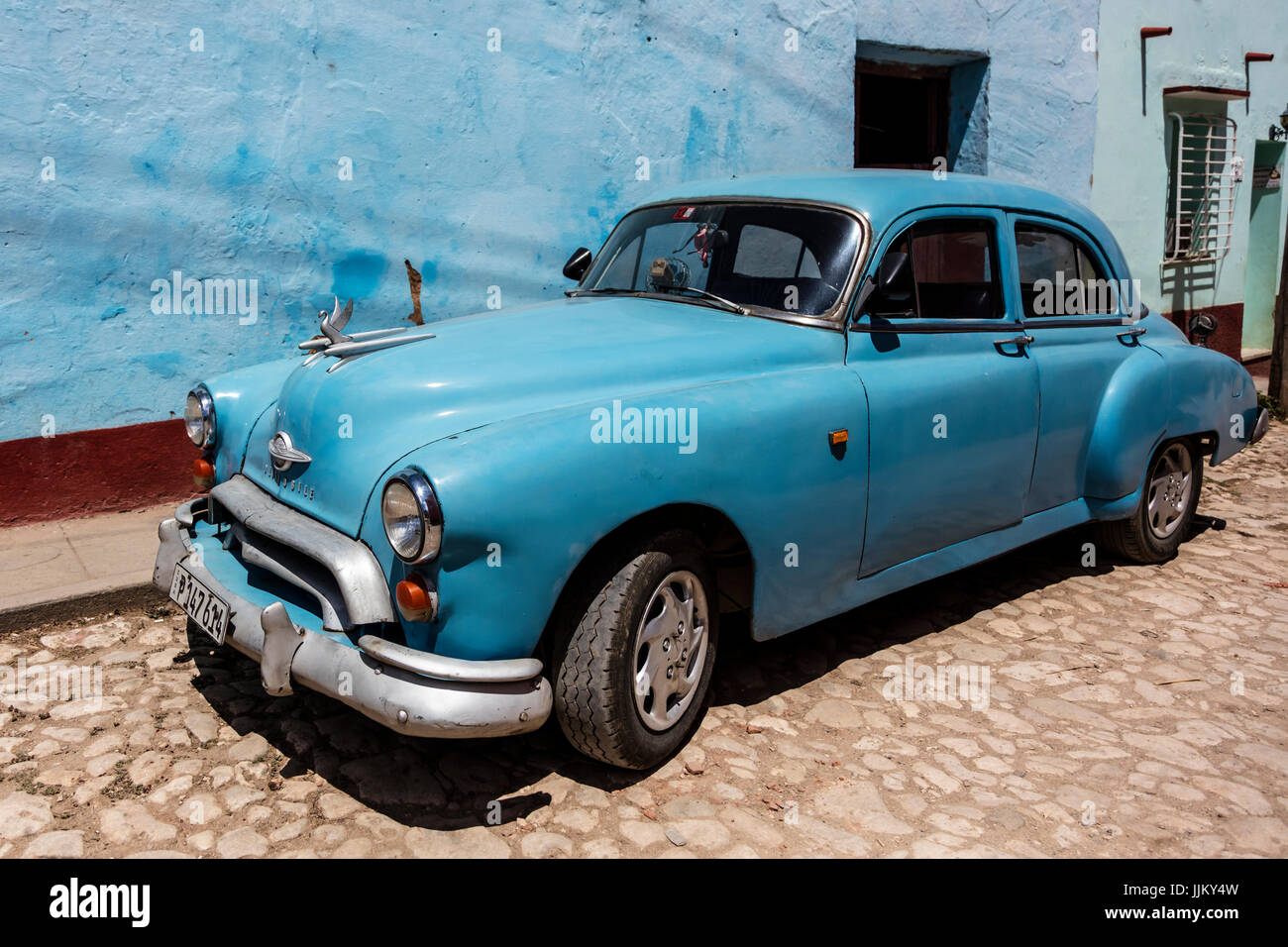 CLASSIC AMERICAN CARS are part of the charm of TRINIDAD, CUBA - Stock Image