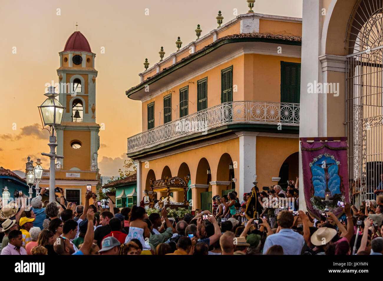 During EASTER known as SEMANA SANTA religious statues are paraded through town at dusk - TRINIDAD, CUBA - Stock Image