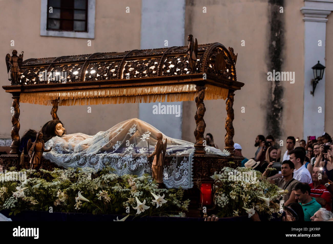 During EASTER known as SEMANA SANTA religious statues are paraded through town at dusk - TRINIDAD, CUBA Stock Photo
