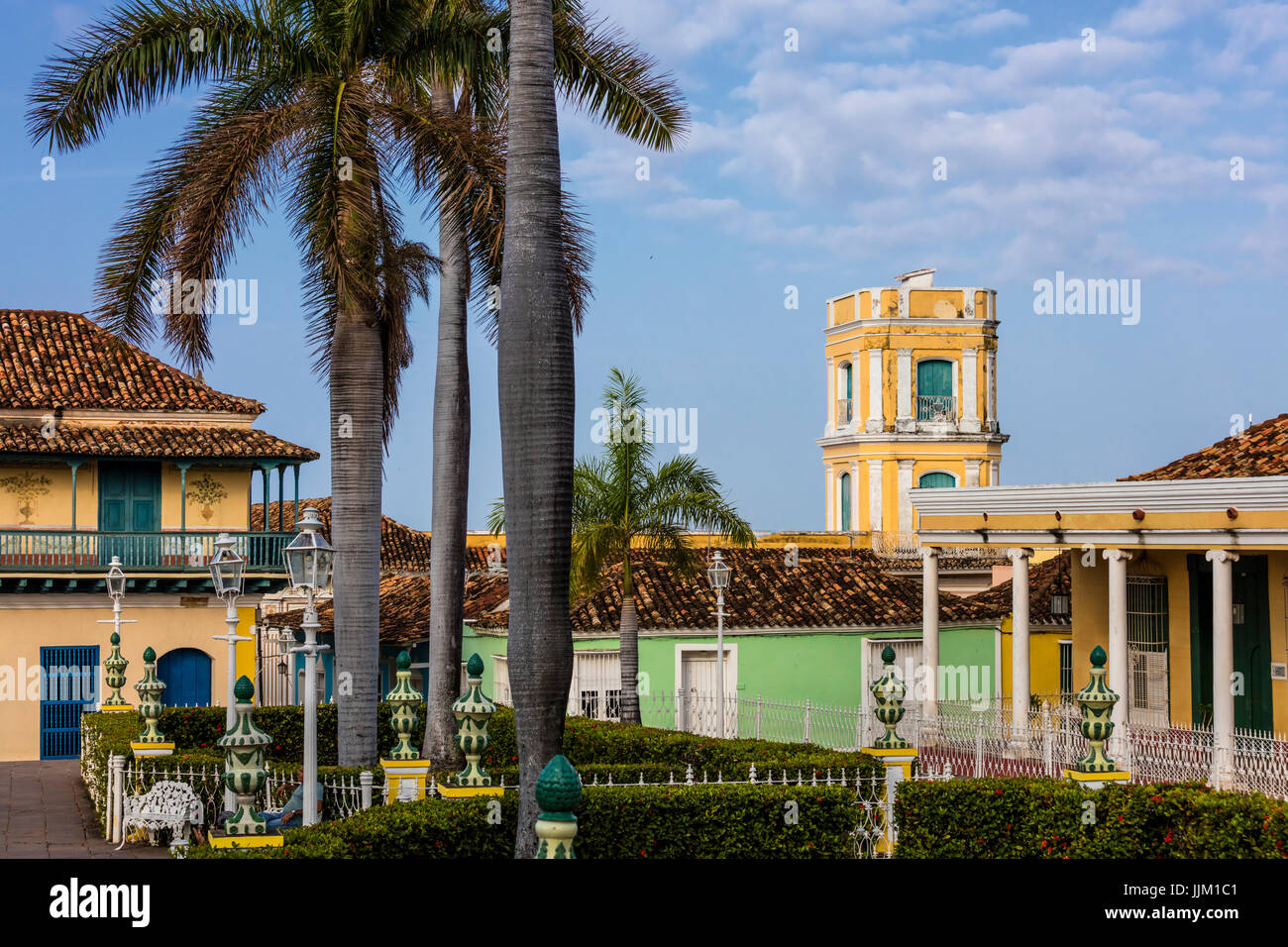 The PLAZA MAYOR is surrounded by historical buildings in the heart of the town - TRINIDAD, CUBA - Stock Image