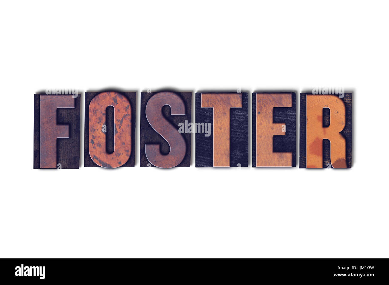 The word Foster concept and theme written in vintage wooden letterpress type on a white background. Stock Photo