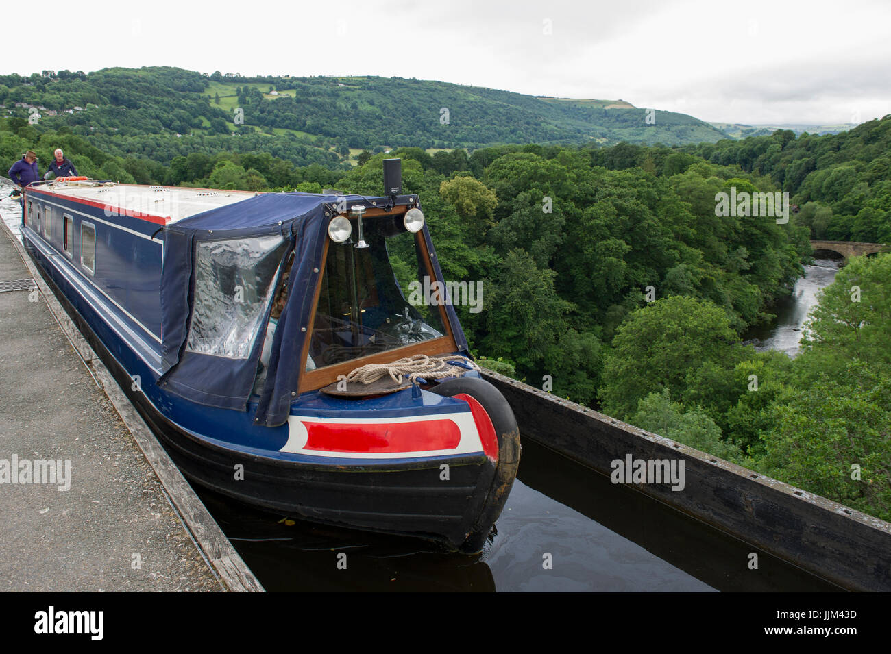 A narrowboat crossing the Pontcysylite Aqueduct on the Llangollen Canal near Trevor in Wales Stock Photo