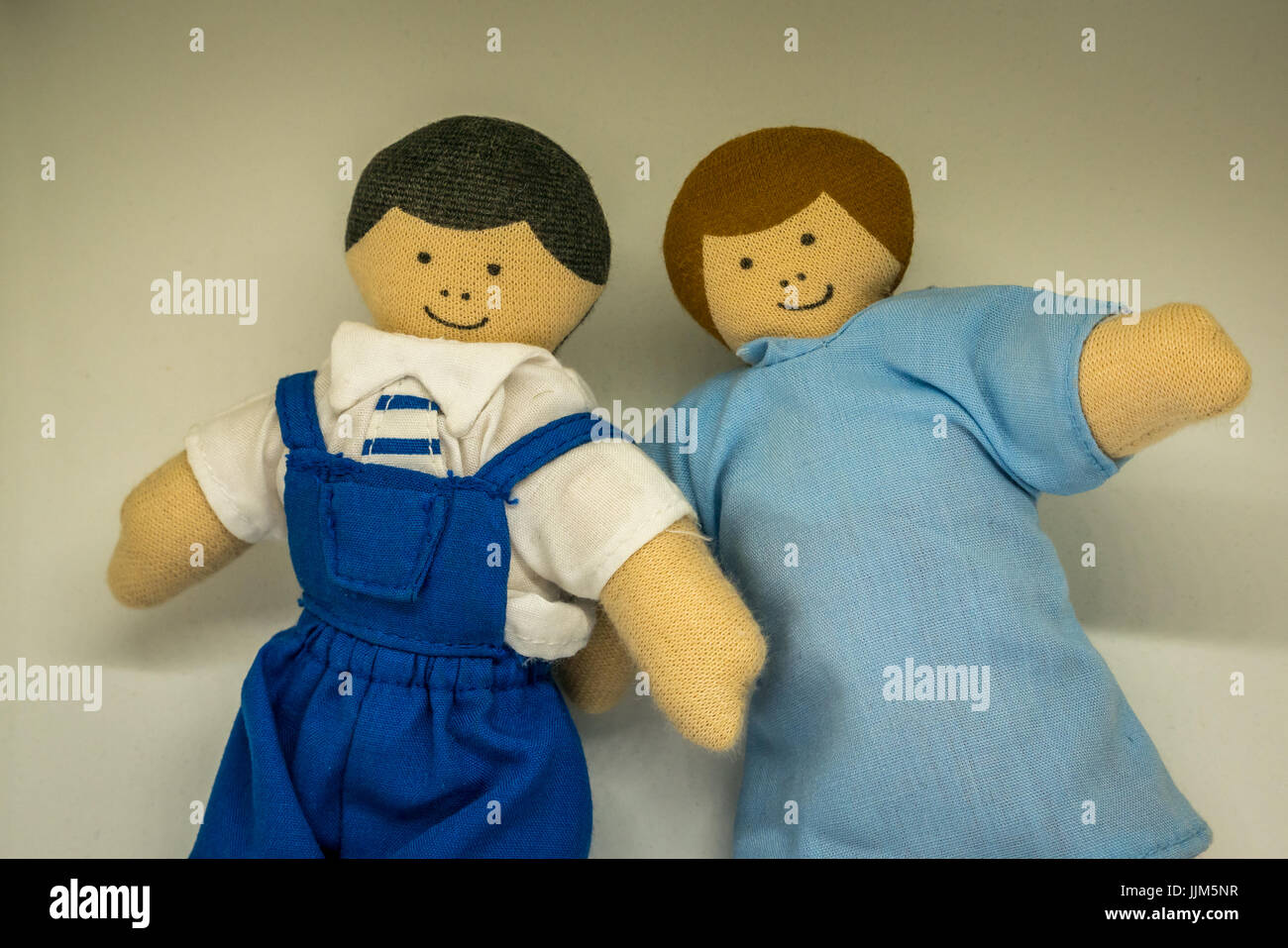 still life of male and female toy dolls against white background to represent parents, couple, family members, relationships, - Stock Image