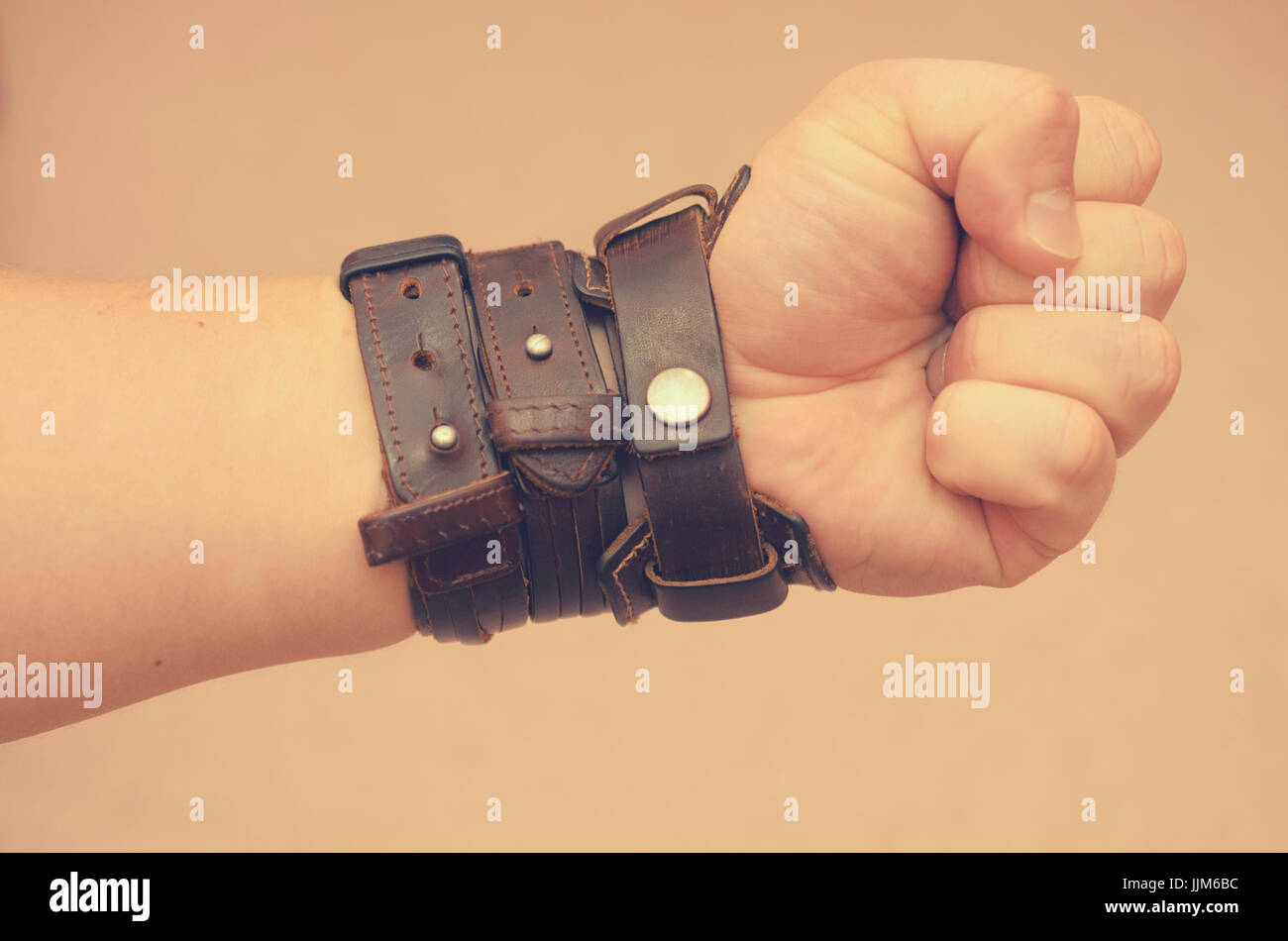 Modern fashionable leather and metal bracelets on the wrist - Stock Image