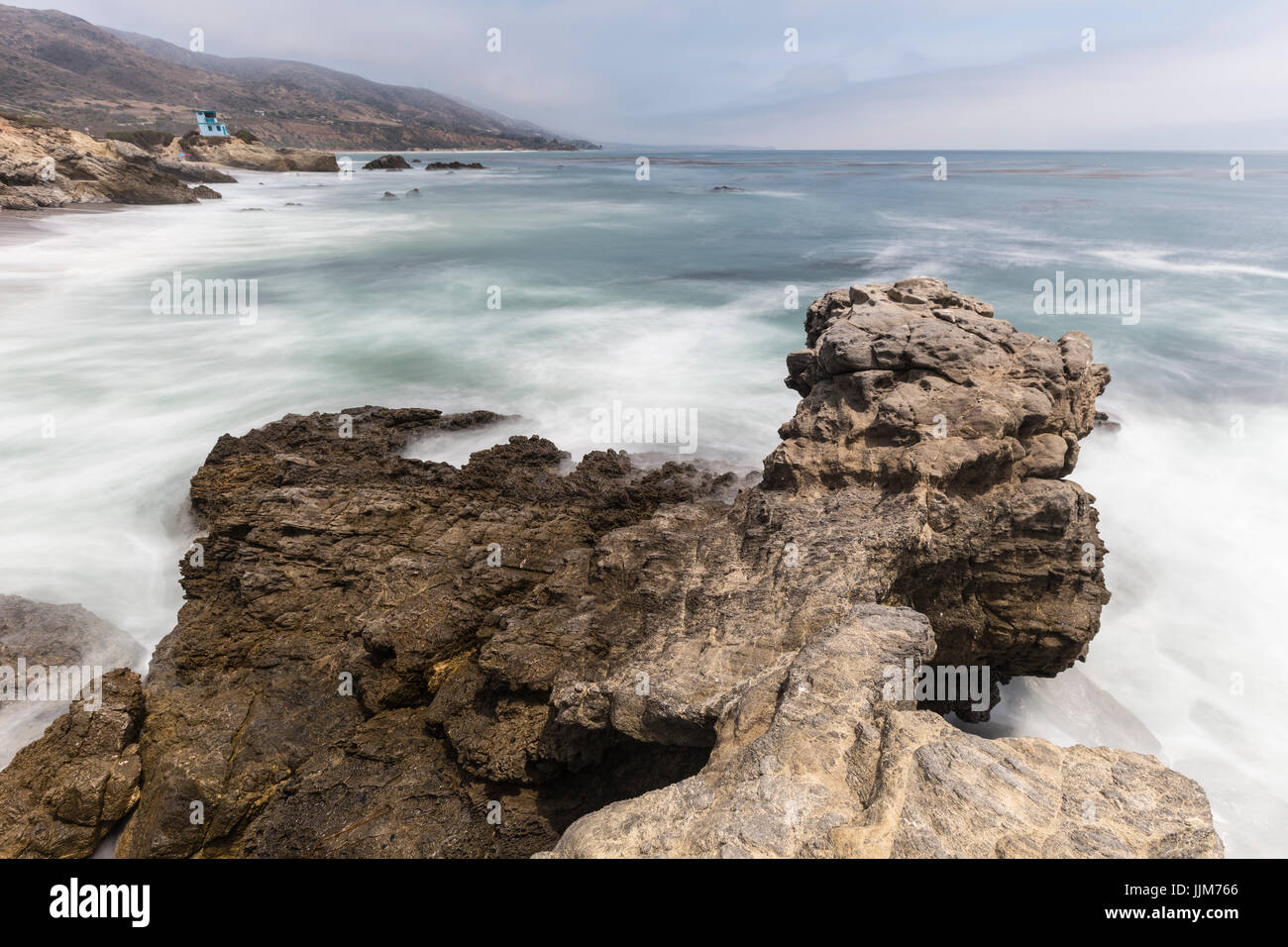 Leo Carrillo State Beach rocky point with motion blur surf in Malibu, California. - Stock Image