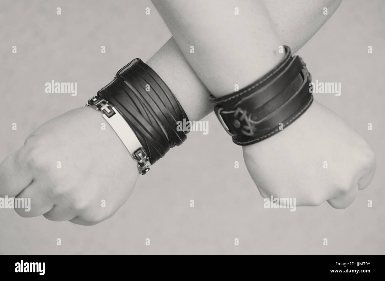 Modern fashionable leather and metal bracelets on the wrist Stock Photo