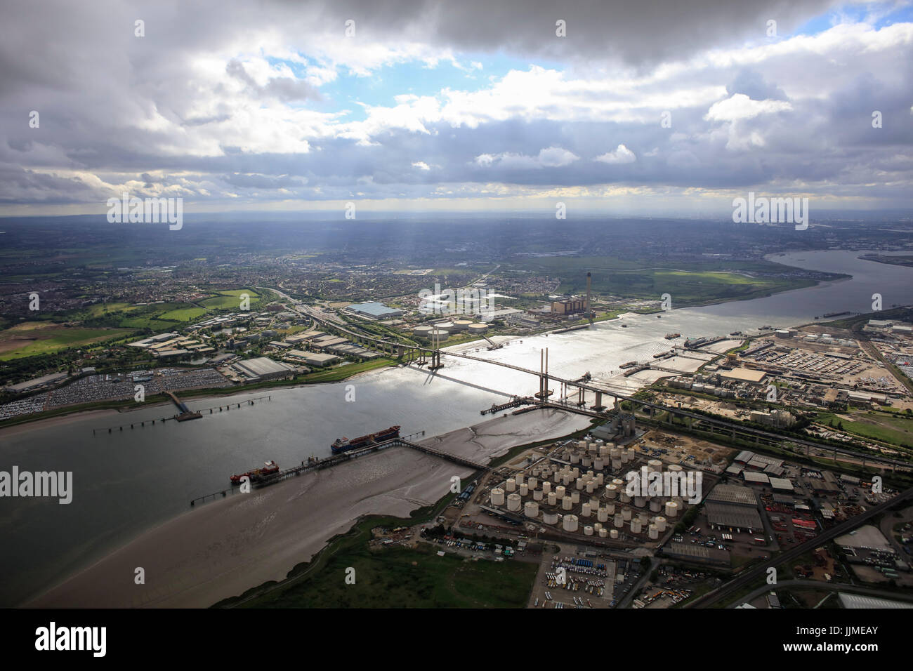 An aerial view showing the QE2 Bridge over the River Thames at Thurrock illuminated by sunlight - Stock Image