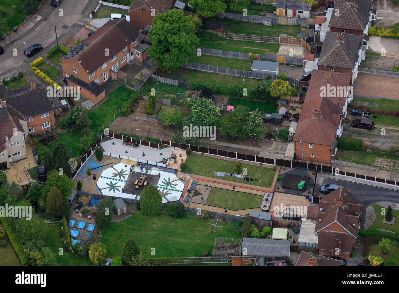 An aerial view of typical suburban back gardens - Stock Image