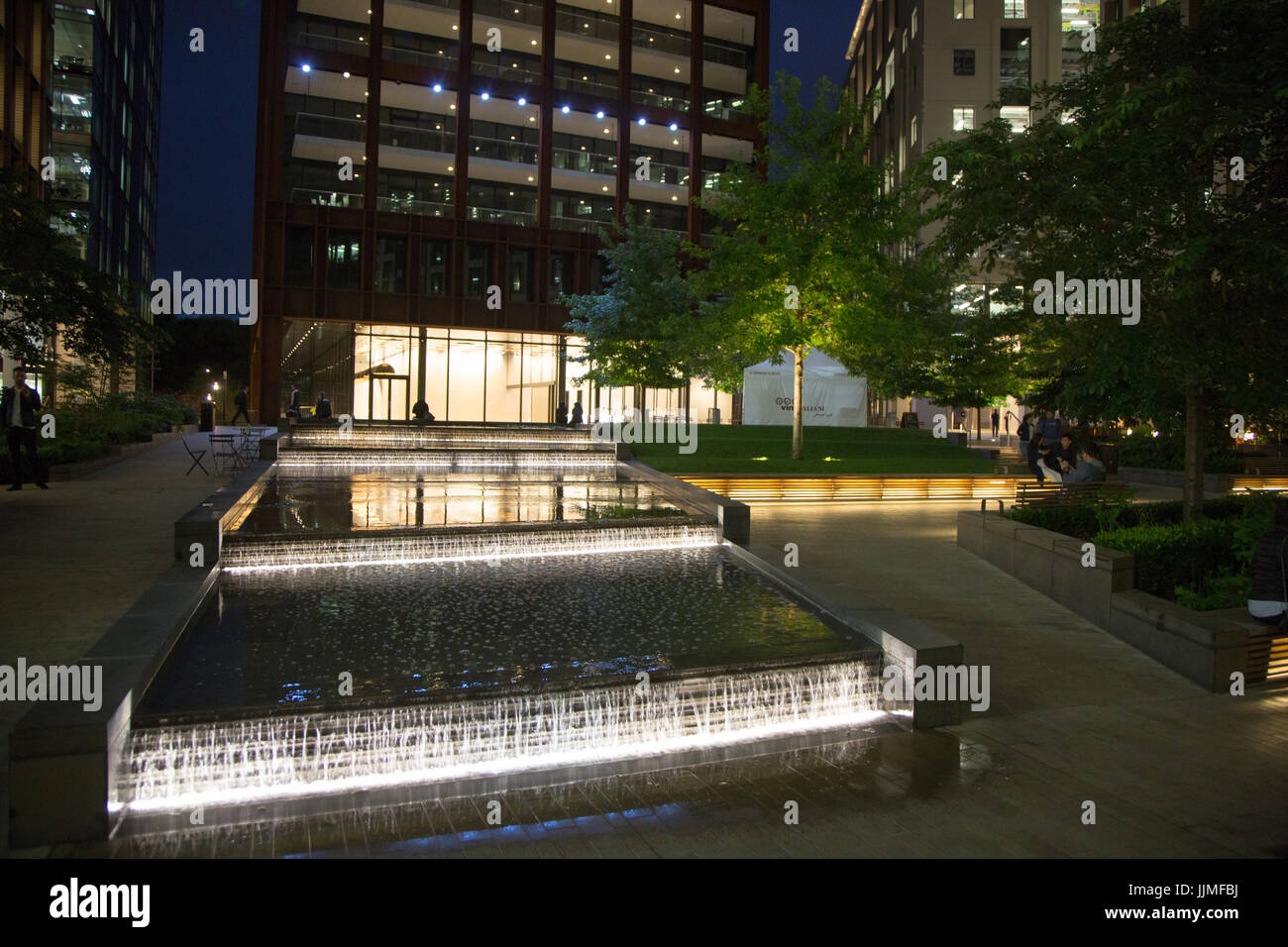 Pancras Square at night, north of King's Cross Station with water feature - Stock Image