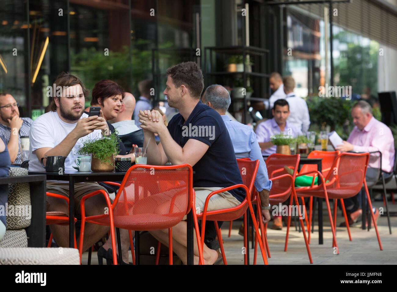Lunch in the modern newly regenerated area of King's Cross, London - Stock Image