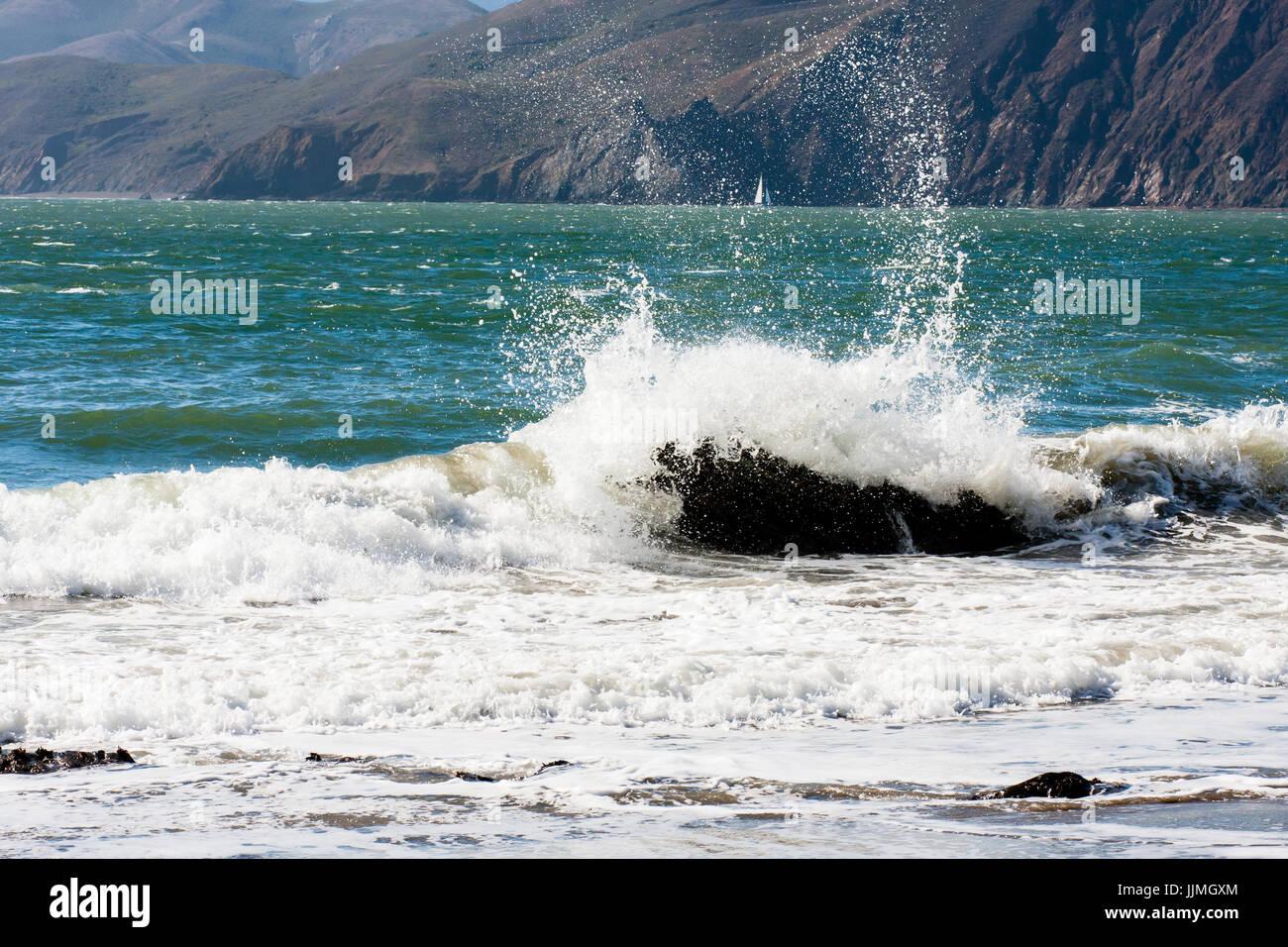 Water crashing into rock - Stock Image