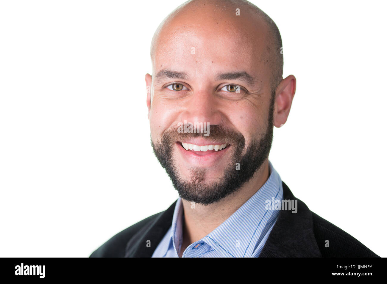 Closeup portrait, professional man with goatee beard in dark blazer and blue shirt, isolated white background - Stock Image