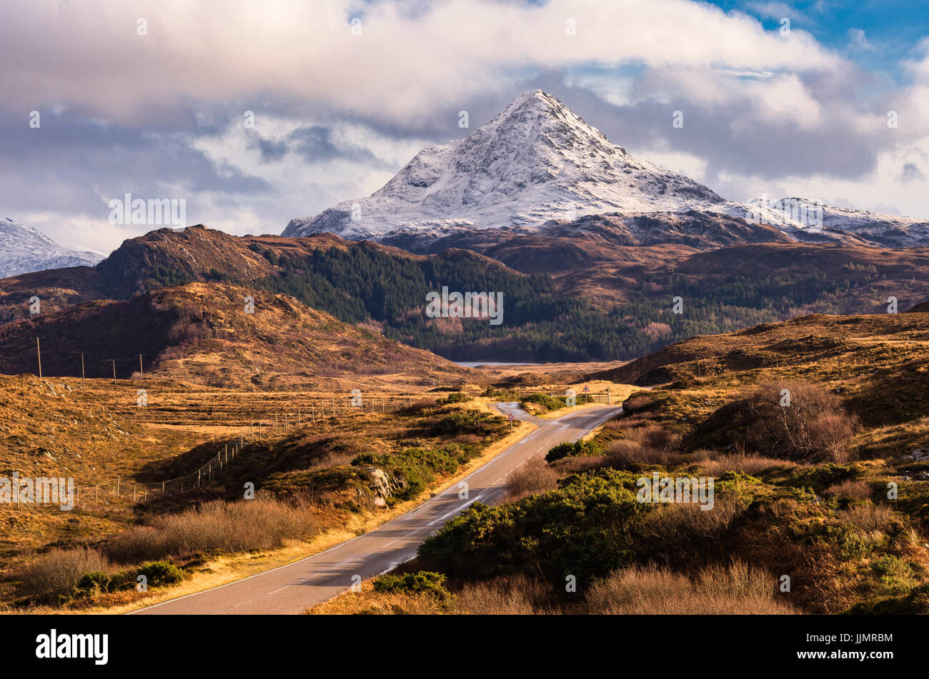Road Leading towards Snow capped Ben Stack in the North of Scotland - Stock Image