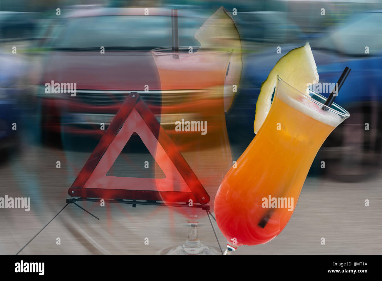 Cocktail glass with melon tip over in the background car crash scene intentionally blurred. Symbolic of alcohol - Stock Image