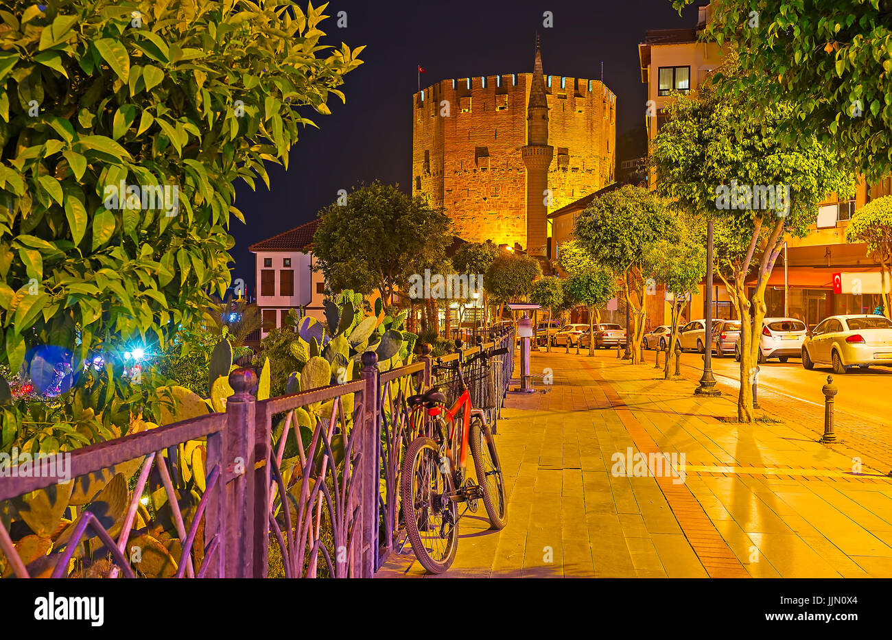 The evening walk along Iskele street to the Kizil Kule - the famous Red Tower of Alanya, Turkey. - Stock Image