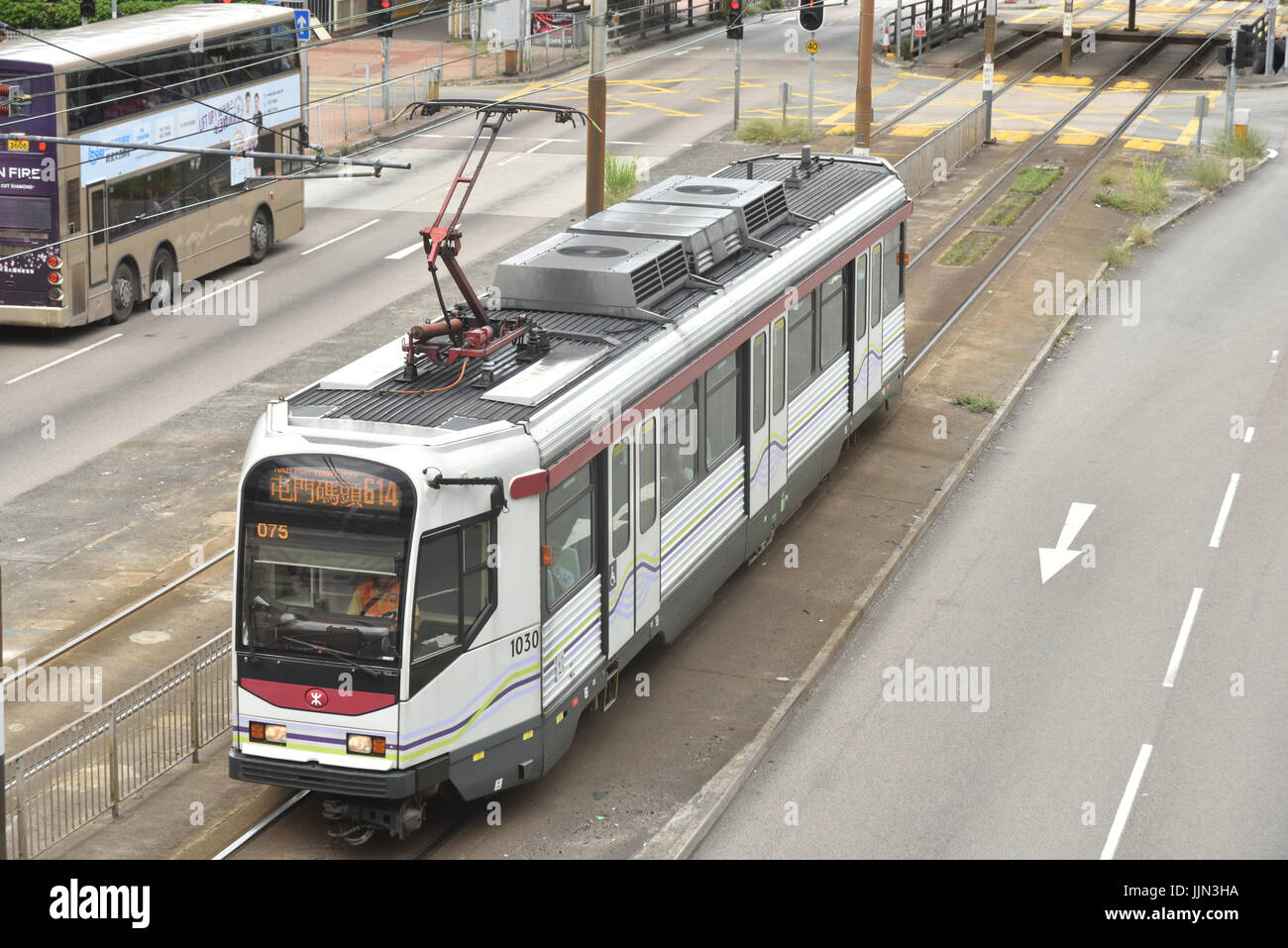 Tram of the Light Rail Transit System which offers swift services between areas of Yuen Long and Tuen Mun districts. - Stock Image