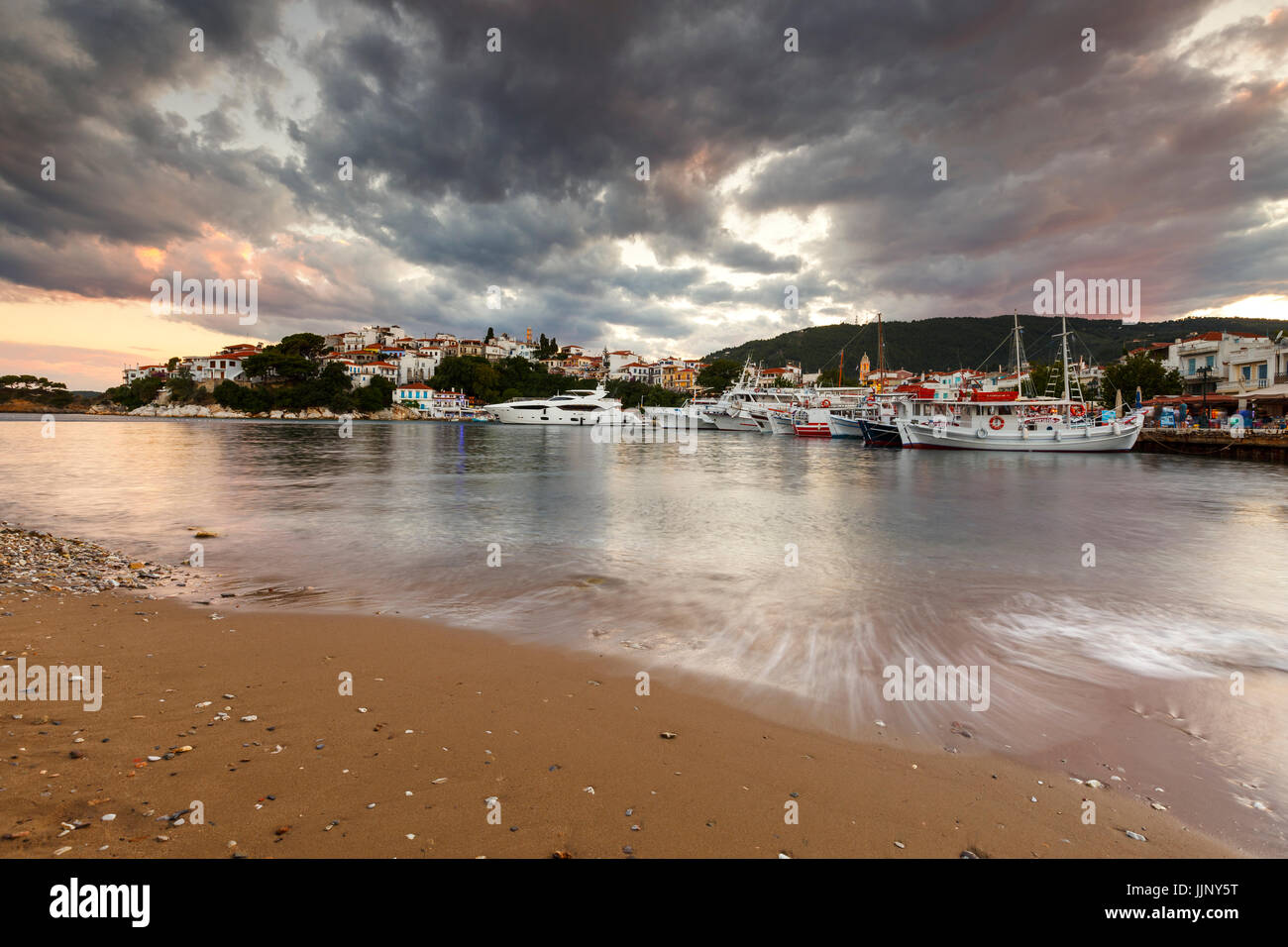 Evening view of the harbour on Skiathos island, Greece. - Stock Image