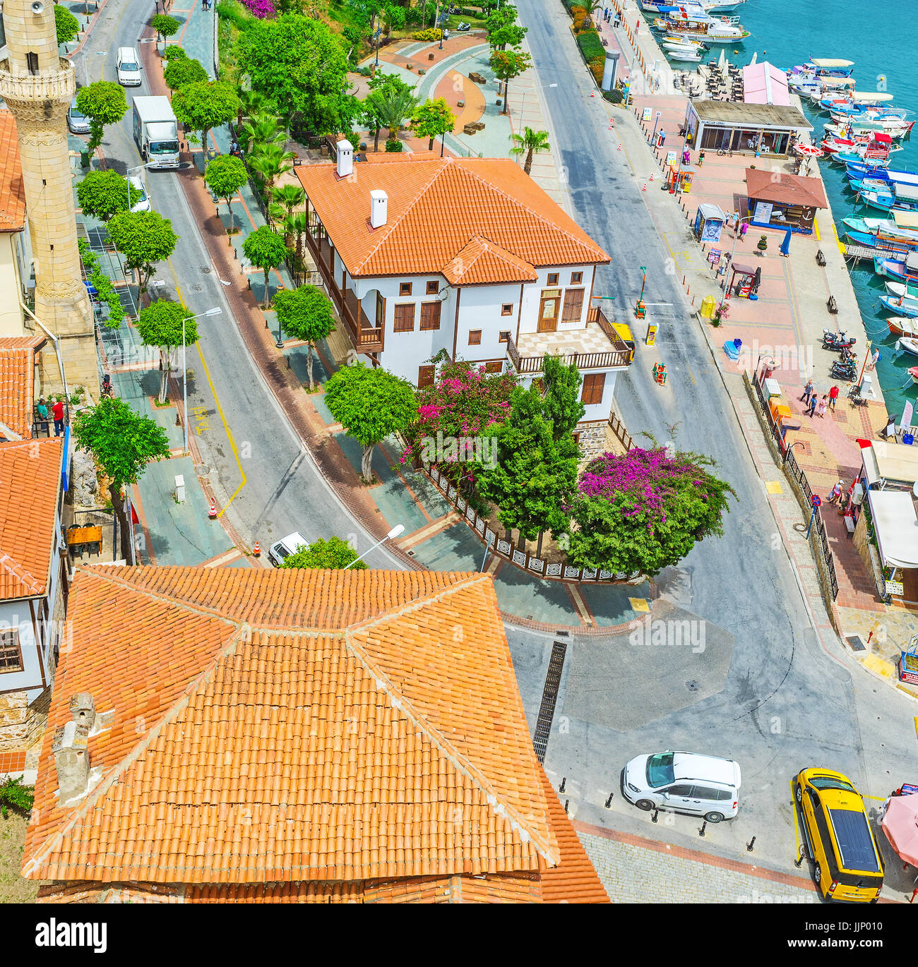 ALANYA, TURKEY - MAY 9, 2017: The corner of Iskele and Rihtim streets in Tophane district, the scenic cotages surrounded - Stock Image