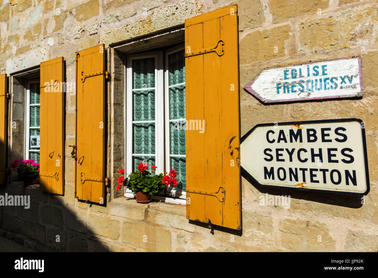 Shuttered window & signs in this old village on the Dropt River near Duras; Allemans-du-Dropt; Lot-et-Garonne; - Stock Image