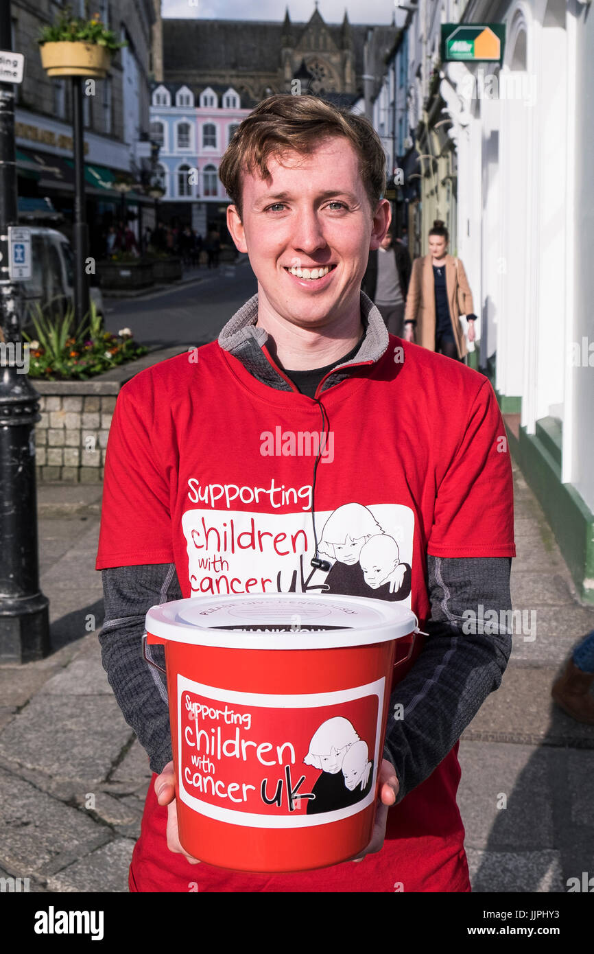 A volunteer collecting donations for Children with Cancer UK. - Stock Image
