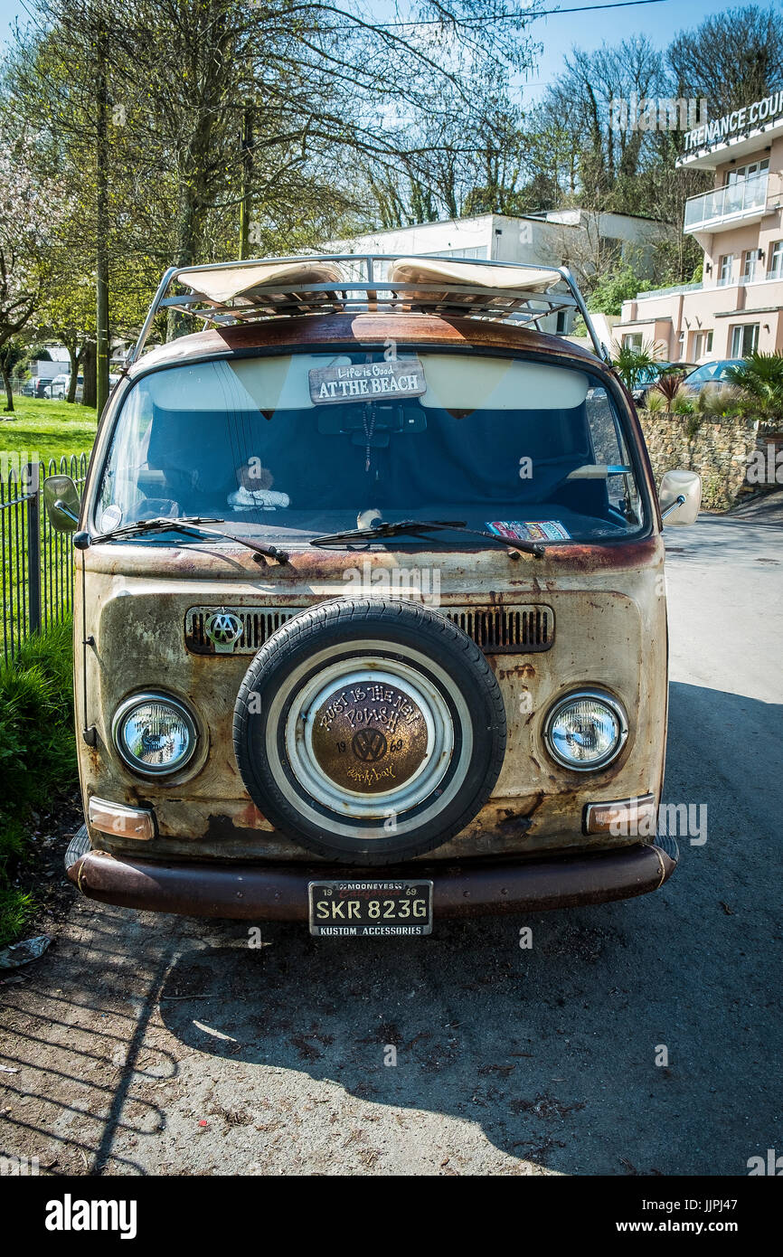 A classic VW Campervan parked at the side of a road in Cornwall. - Stock Image