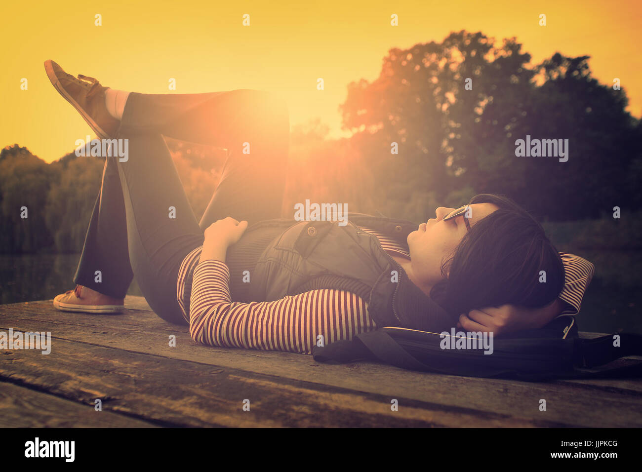 Vintage photo of relaxing woman on a pier Stock Photo