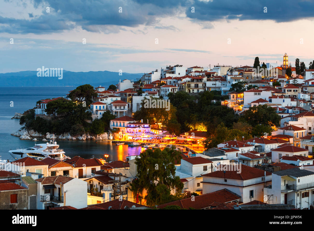 Evening view of Skiathos town in Sporades, Greece. - Stock Image