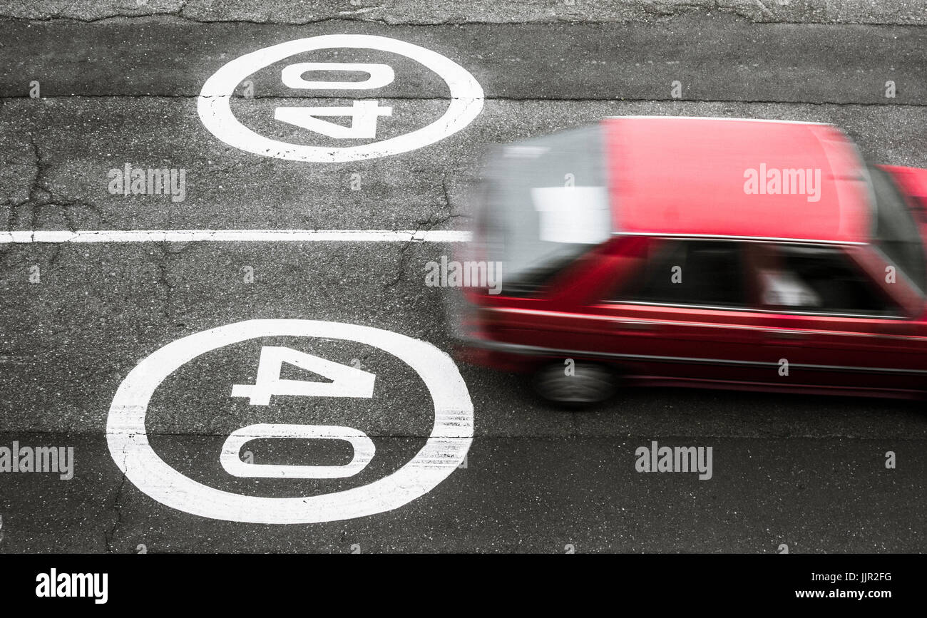 40 speed limit sign on road in Spain Stock Photo