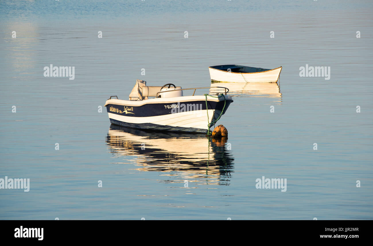Two baots moored in harbour at Arrecife, Lanzarote. - Stock Image