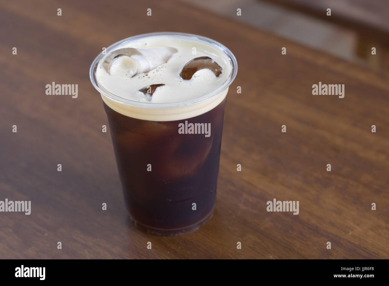 Sparkling Nitro cold brew coffee in take away cup ready to drink - Stock Image