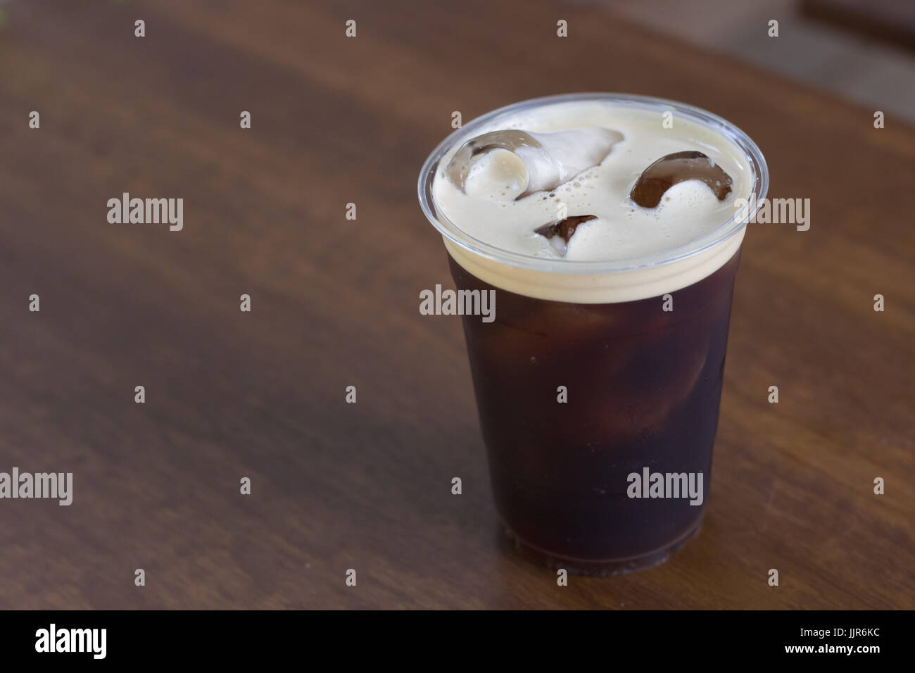 Sparkling Nitro cold brew coffee in take away cup ready to drink Stock Photo