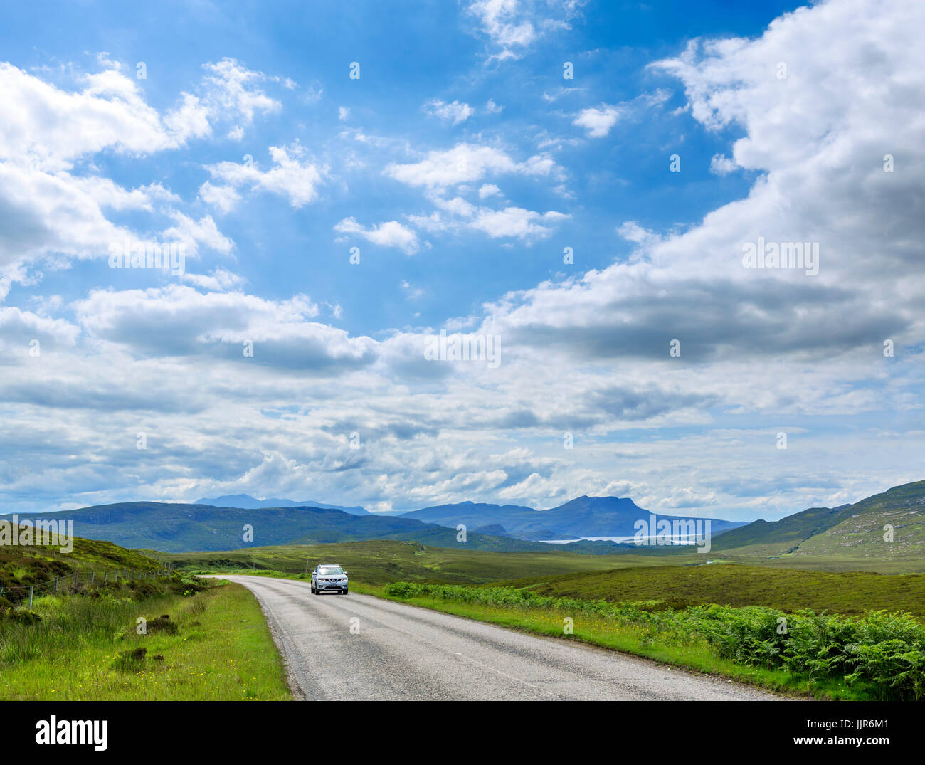 Car on the A835 north of Strathcanaird, part of the North Coast 500 scenic route, Wester Ross, Highland, Scotland, - Stock Image