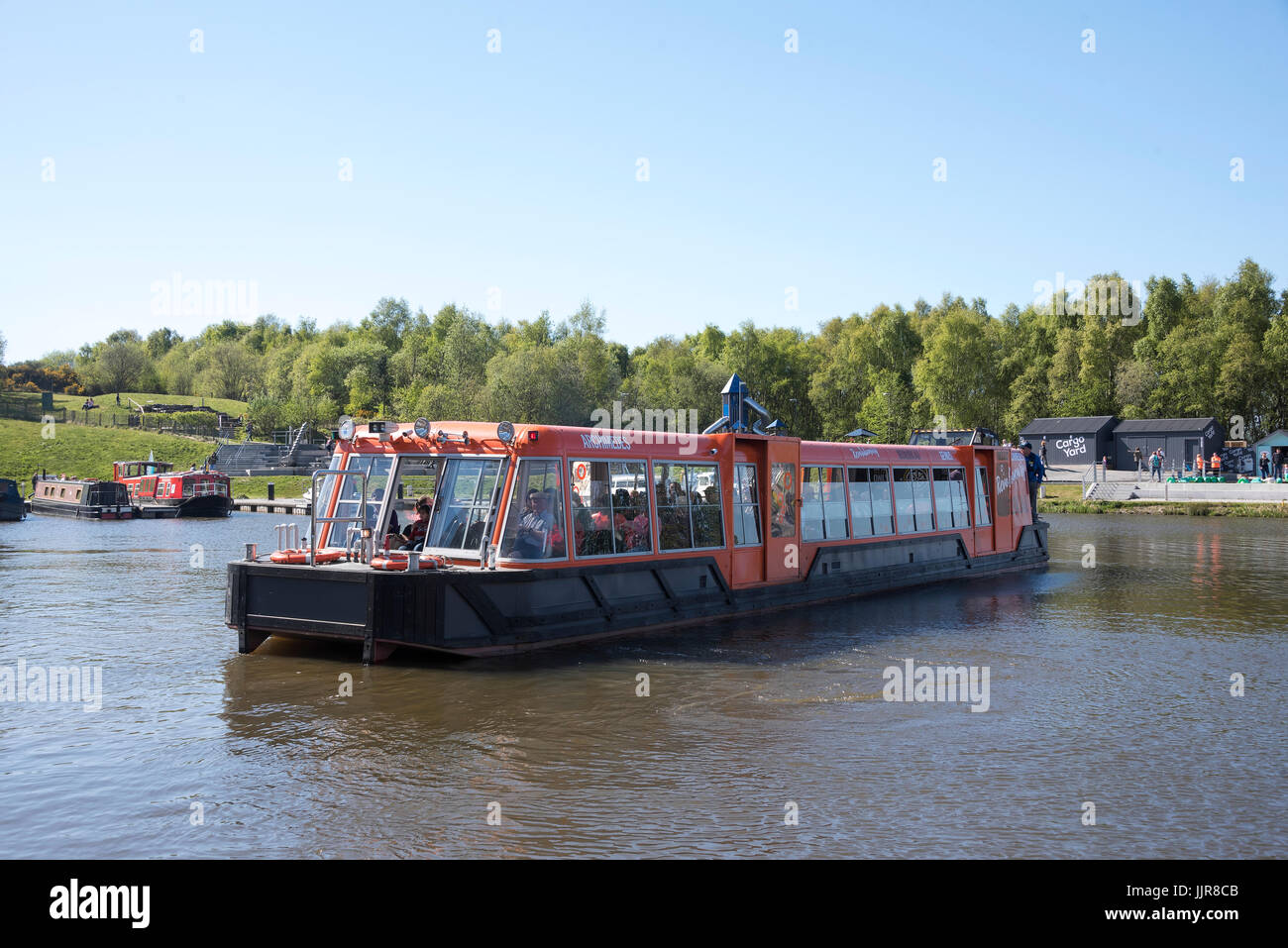 Boat trip visitor attraction on the Forth & Clyde and Union canals at the Falkirk Wheel. - Stock Image