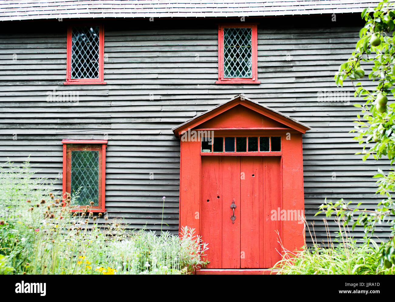 weathered colonial house with brown shingles and red door in Salem Massachusetts  sc 1 st  Alamy & weathered colonial house with brown shingles and red door in Salem ...