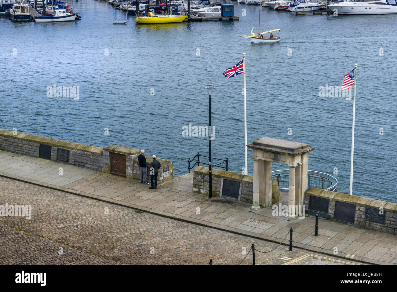 The Mayflower Steps in Plymouth, Devon where the Pilgrim Fathers departed for the new world in 1620. - Stock Image