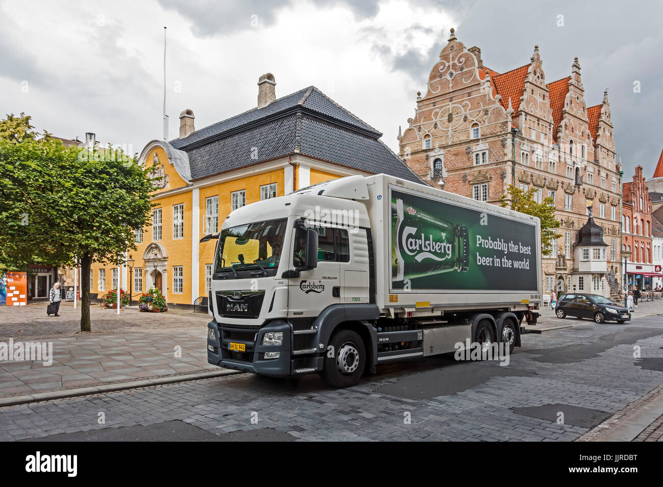 Carlsberg beer delivery vehicle in Oesteraagade near Nytorv in Aalborg Jutland Denmark Europe with Jens Bang Stenhus - Stock Image