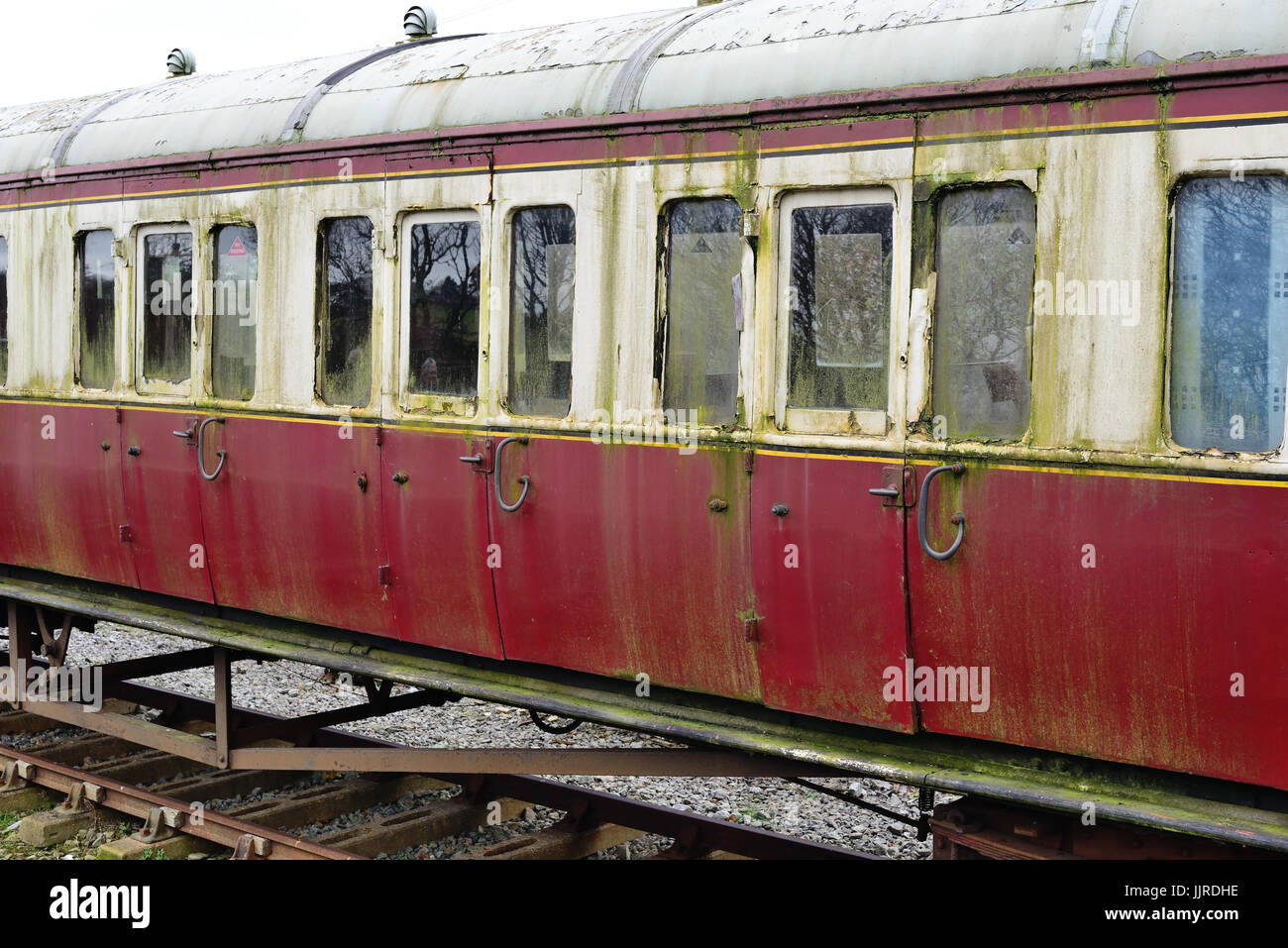 A dilapidated railway carriage awaiting restoration. - Stock Image