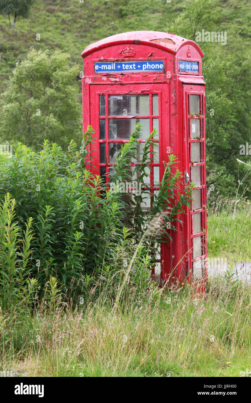 A phone box situated near Tulloch rail station promoting e-mail, text and phone services - Stock Image