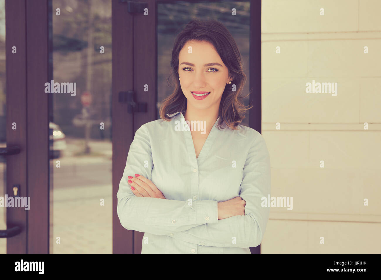 Attractive real estate agent woman - Stock Image