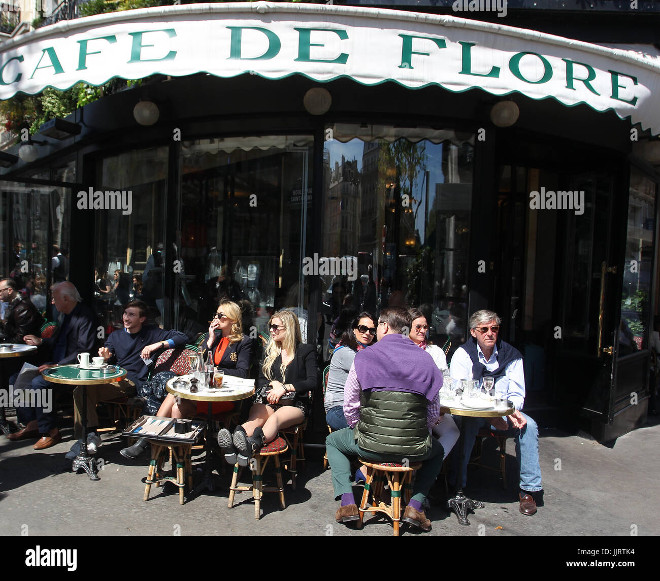 The Cafe de Flore  is one of the oldest coffeehouses in Paris. Located on Boulevard Saint-Germain it's a famous - Stock Image