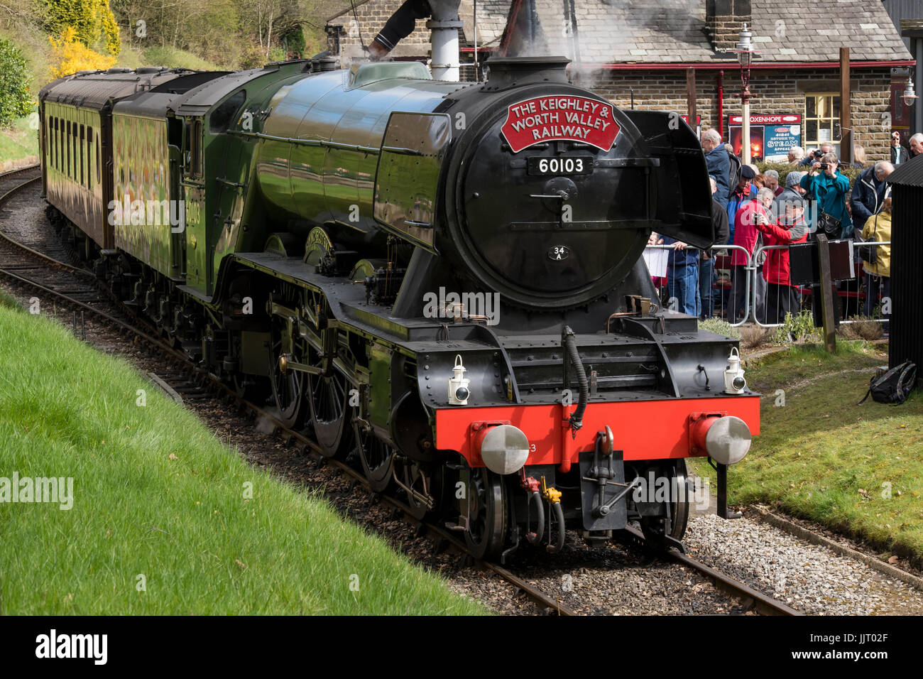 People & iconic steam locomotive LNER Class A3 60103 Flying Scotsman puffing smoke on tracks - Keighley and - Stock Image