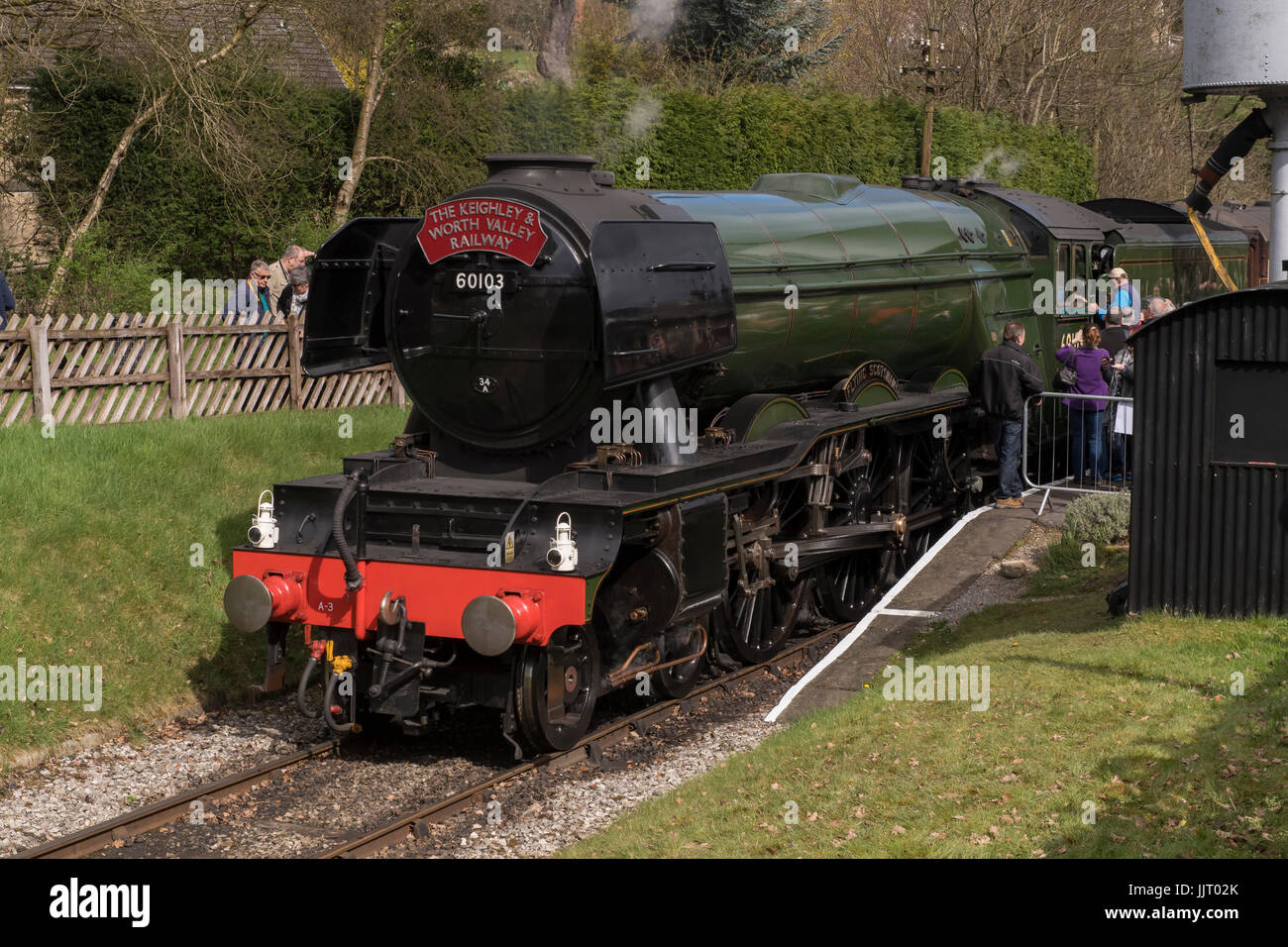 People view iconic steam locomotive, LNER Class A3 60103 Flying Scotsman, on rail tracks - Keighley and Worth Valley - Stock Image
