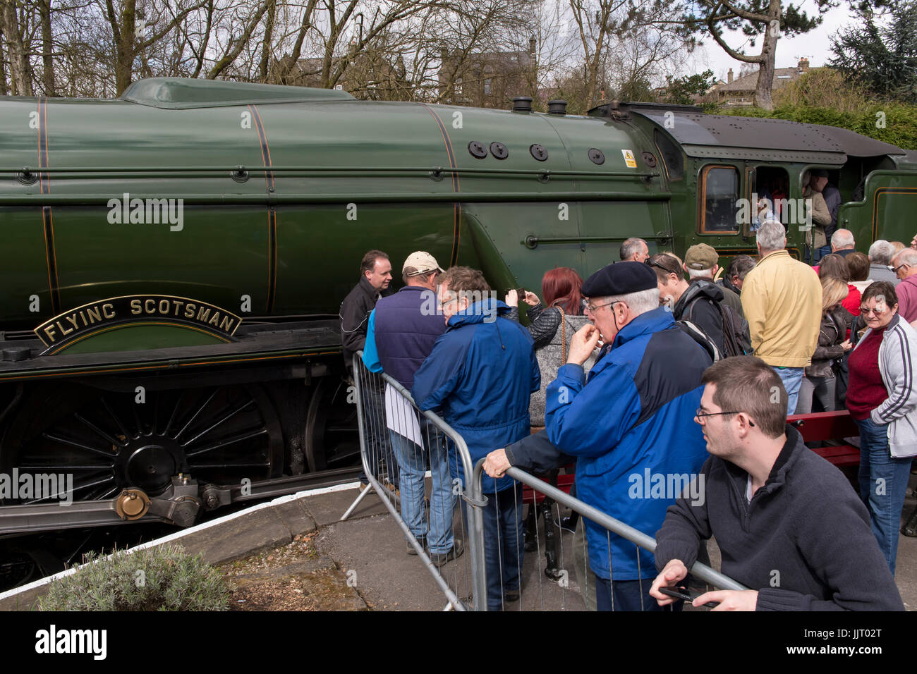 Crowd of people view iconic steam locomotive engine, LNER Class A3 60103 Flying Scotsman - Keighley and Worth Valley - Stock Image