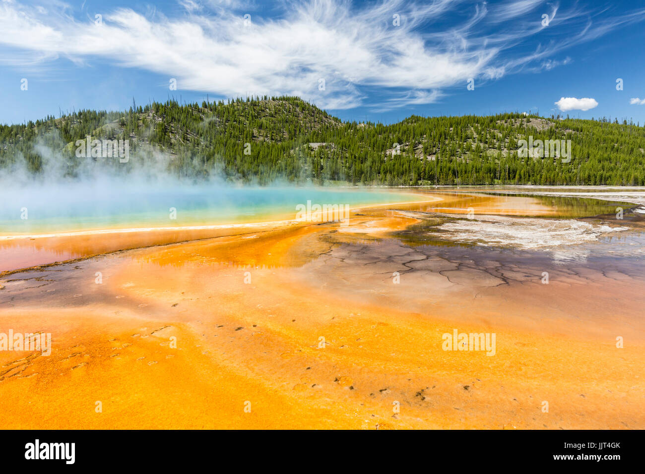 The vivid rainbow colors of the Grand Prismatic Spring in Yellowstone National Park, Wyoming - Stock Image