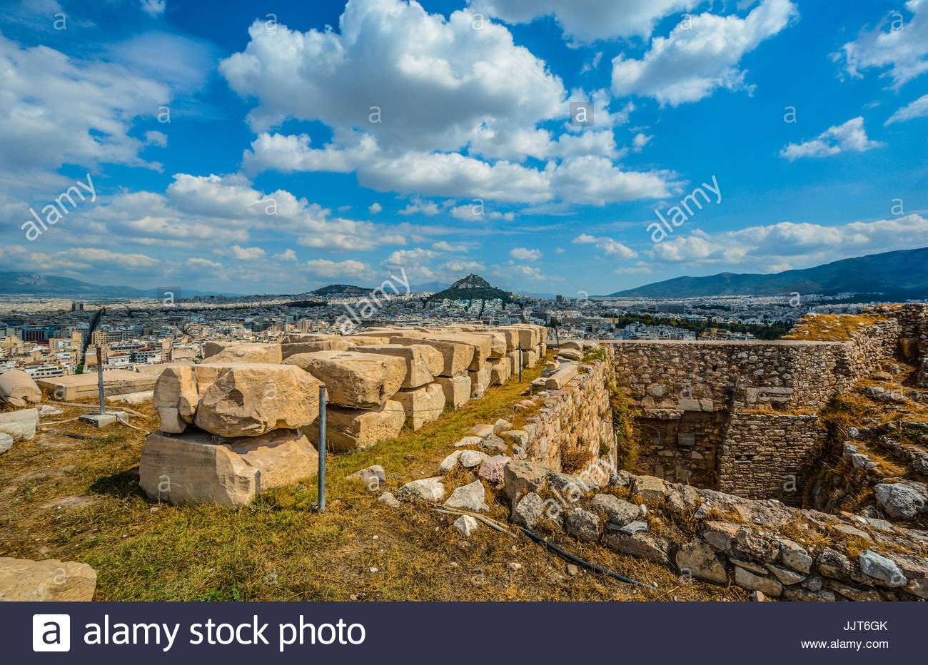 View of Likavitos Hill from Acropolis Hill in Athens Greece on a warm summer day with powder blue skies - Stock Image